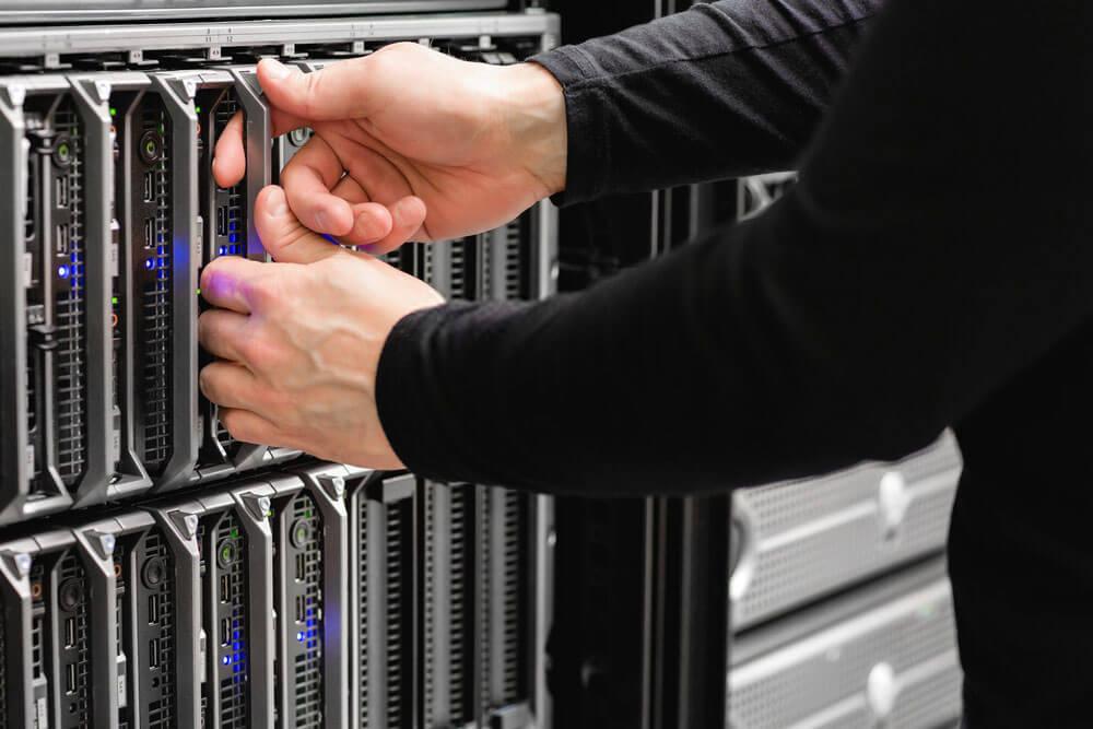 hands close up shot pulling blade server
